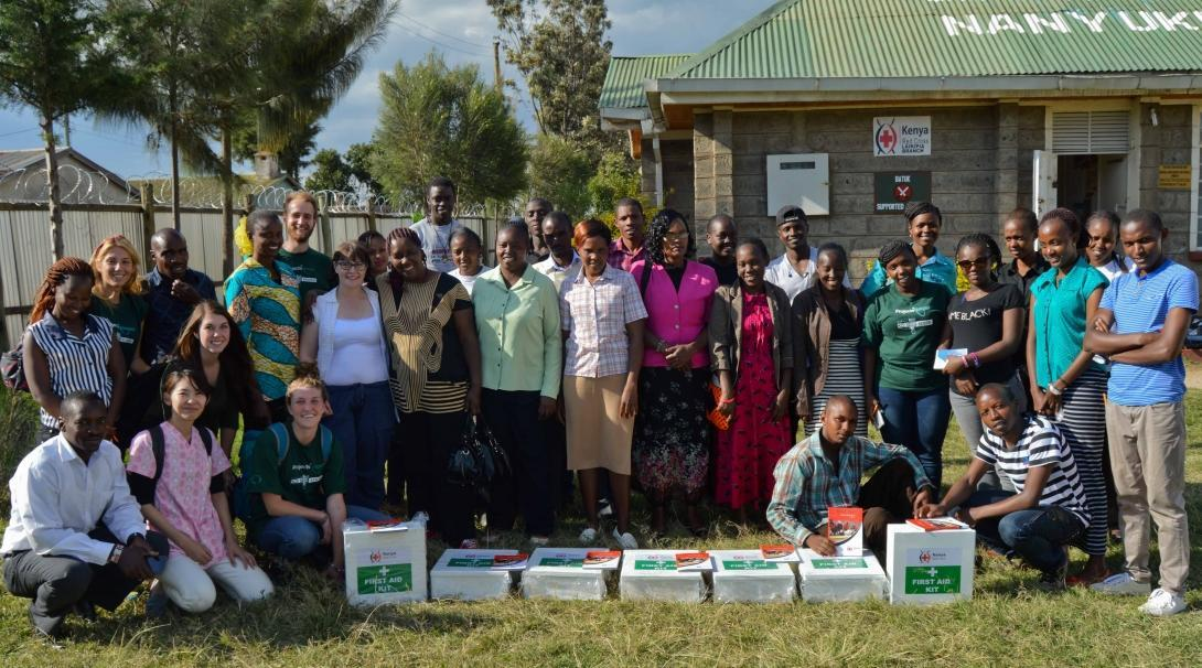 High school students and local staff donate first aid kits on our medical internship in Kenya